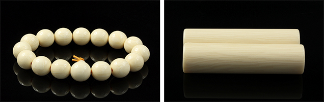 A bracelet and two seal stamps made from resin imitation ivory.