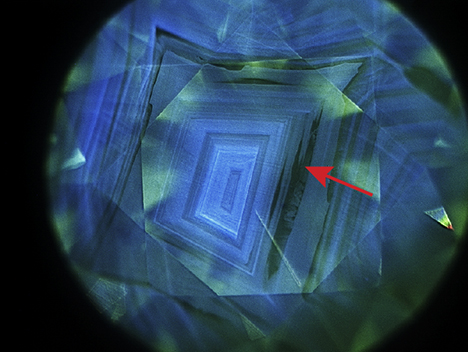 Strong blue fluorescence and inert zones seen in the DiamondView image.