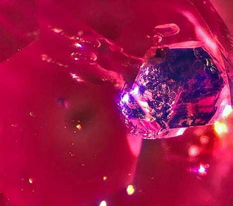 Bright blue lazurite inclusion in Mogok ruby.