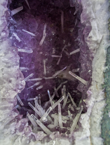 People from all over the world collect Brazil's finest mineral specimens, such as this amethyst and rock crystal quartz geode. Photo by Robert Weldon/GIA