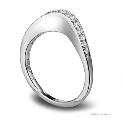 Side view of platinum band designed by Michael Bondanza, featuring diamonds channel-set into a curved top.