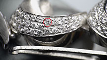 A CVD synthetic diamond (circled in red) was mounted in an earring.