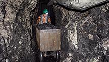 Pushing carts of ore through the tunnels at Los Españoles