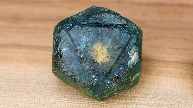 The rough sapphire crystal as it was mined.