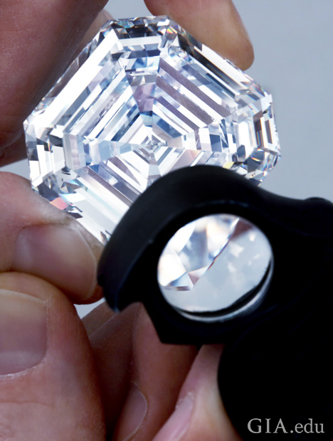 Looking at a large diamond with a loupe