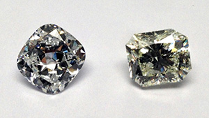 These two large synthetic diamonds were produced using HPHT growth methods by the Russian firm New Diamond Technology. The 4.30 ct specimen on the left has D color and SI1 clarity. On the right is a 5.11 ct sample with K color and I1 clarity. Photo by Wuyi Wang.