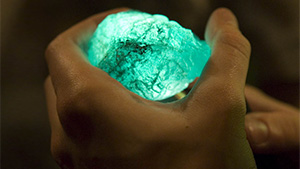 A miner holds an emerald in the mine office in the village of Coscuez, Colombia. Photo by Eric Welch/GIA