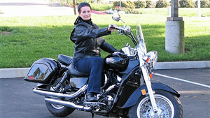 Rebecca Buys sits on her motorcycle.