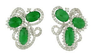 The stones in these earrings have the appearance, colour and gemmological properties of fine-quality jadeite. However, Raman analysis showed they were actually omphacite.