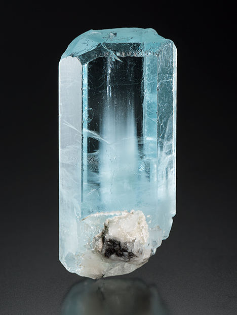 This aquamarine crystal showed iridescence as it is turned under a moving light source.