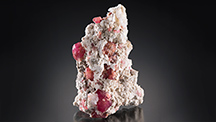 Raspberry-red grossular garnet in matrix.