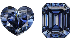 On the left is a 5.26 ct Fancy deep blue heart shape HPHT synthetic diamond. On the right is a 5.27 ct Fancy deep blue emerald cut HPHT synthetic diamonds.