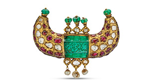 Horn shaped jewel pendant featuring emeralds, rubies, diamonds and pearls, and shows engravings in Arabic.