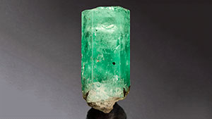 Rough emerald with mobile inclusion.