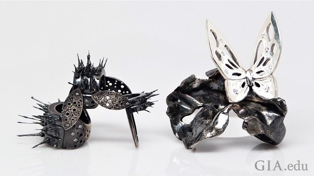The caterpillar ring on the left is jointed so it can move and the butterfly ring on the right features dark and light sterling silver: a light butterfly on a dark cocoon.