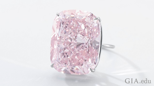 The pink diamond is a cushion-modified brilliant cut set in a ring.