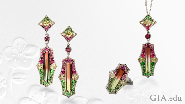 Shield-shaped tourmaline pieces: earrings, ring and pendant. The shield of the earrings and pendent drop from a square-shaped piece.