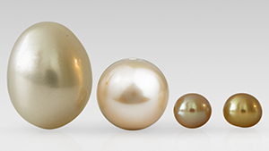 Three cultured pearls, one natural