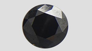 Opaque round brilliant black diamond.