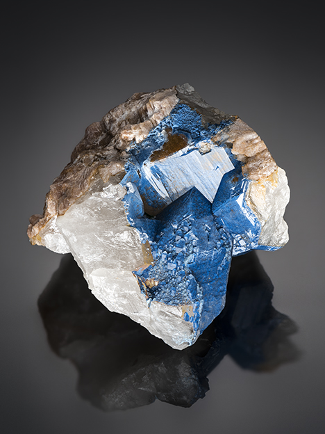 Shattuckite typically forms aggregates of circular to spherulitic masses composed of acicular crystals