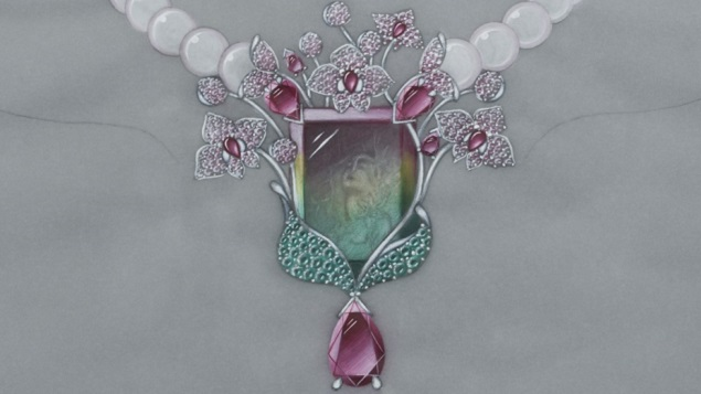 "A carved watermelon tourmaline pendant with an image of ""Dreaming Woman"