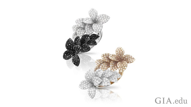 Flower design rings. One is black and colorless invisibly set diamonds and one is colorless and light brown diamonds.
