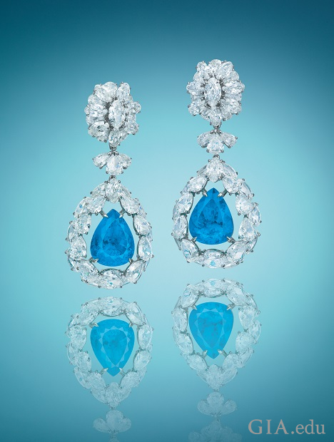 Pear-shaped Paraíba tourmalines are framed by pear-shaped diamonds and drop from more pear-shaped diamonds.