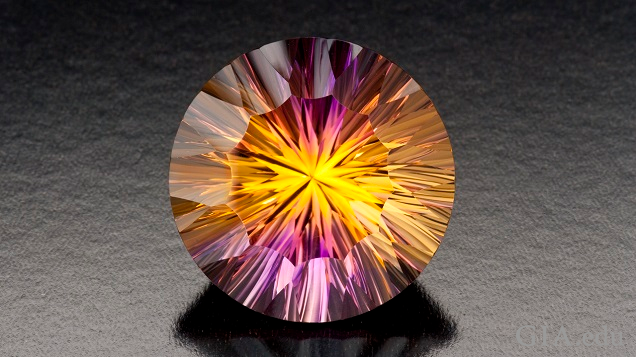 Bursts of yellow and purple radiate throughout this round cut amertrine.