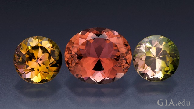 A golden yellow (round), orange (oval) and green (round) set of gems.
