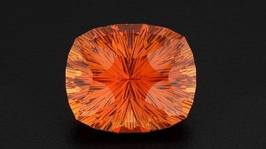 A bright orange, multi-faceted gem.