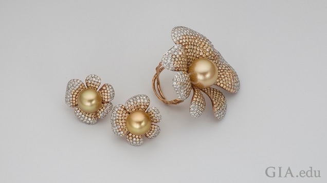 Golden-hued pearls are at the center of each flower and metals two-toned petals frame them.