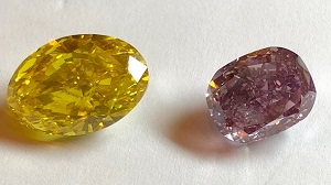 A yellow diamond on the left and a purple-pink diamond on the right.