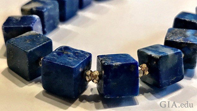 A necklace of cubed-shaped lapis beads separated by 22K gold beads.