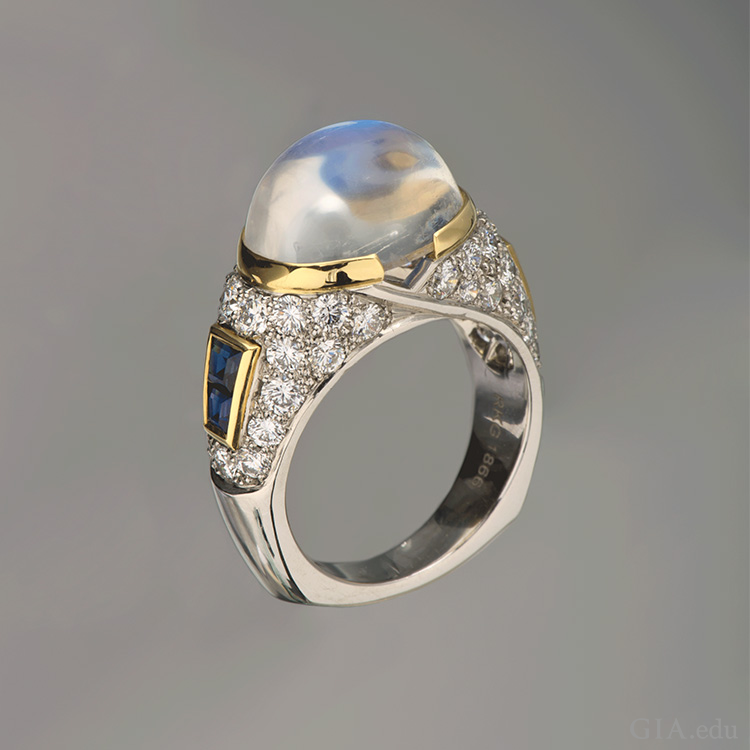 A platinum ring boasts the June birthstone, an 8.34 carat moonstone set with sapphires.
