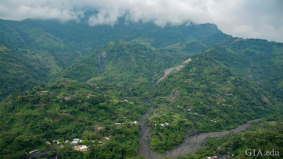 The lush green Andes Mountains tower over the deep tropical valleys around Muzo. Photo: Robert Weldon/GIA