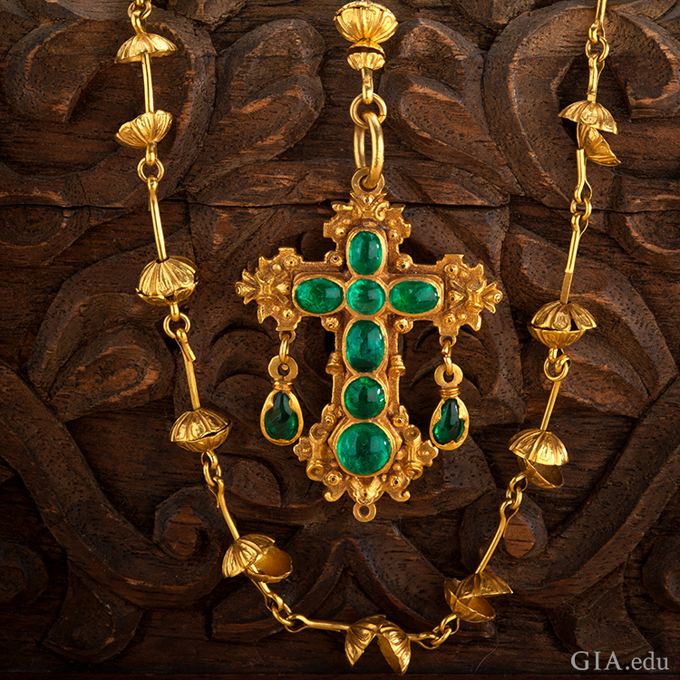 The May birthstone is the focal point of a gold rosary necklace with a cross made of seven emeralds, recovered from the Nuestra Señora de Atocha shipwreck.