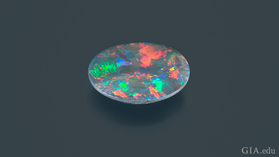 Specks of pink, green, blue, and orange are found on the colorful 1.72 carat October birthstone, opal.