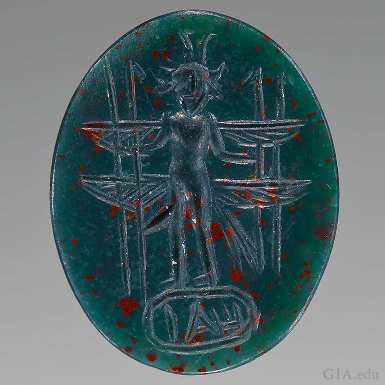 An engraved bullae bloodstone cameo from the Roman Empire features the March birthstone.