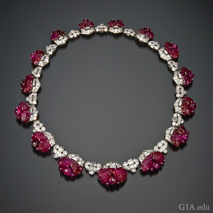 Art Deco carved ruby and diamond necklace by Mauboussin circa 1930. The ruby beads are secured to the frame by white metal posts capped with a tiny diamond. Photo: Robert Weldon/GIA. Courtesy: Private Collector