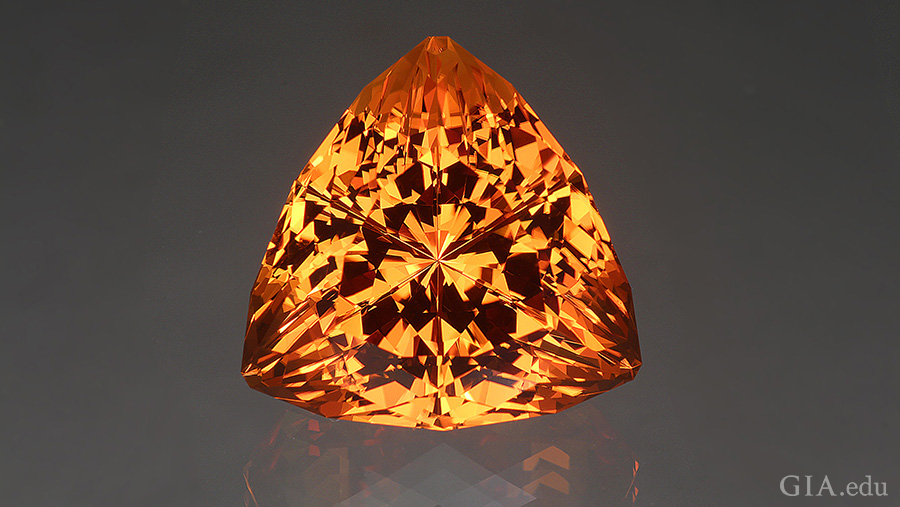 The November birthstone is shown off with a fantasy cut that unleashes the fire within this 43.49 carat orange citrine.
