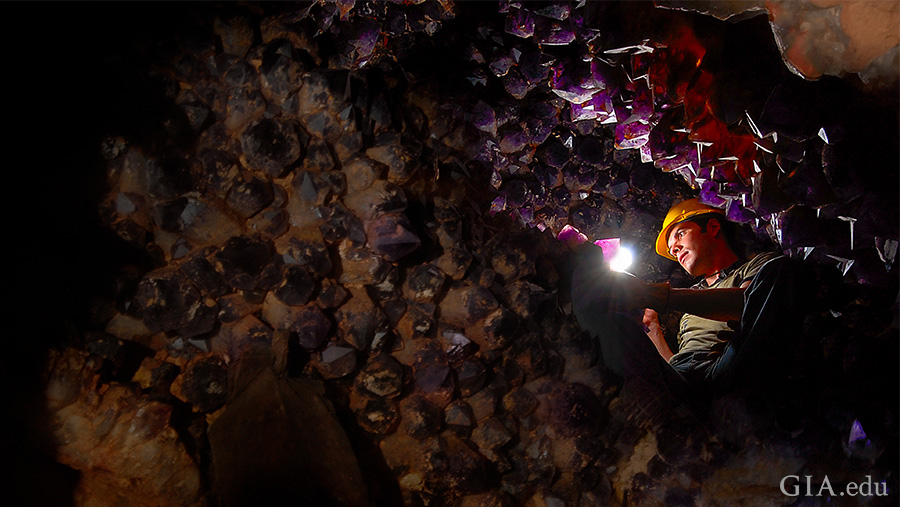 A miner shines a light to reveal thousands of purple amethyst and yellow citrine crystals lining the walls of the Anahí mine in Bolivia, where the November birthstone can be found.