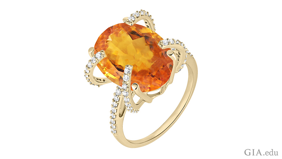 The November birthstone is shown off in this orange oval cut citrine ring with diamonds.