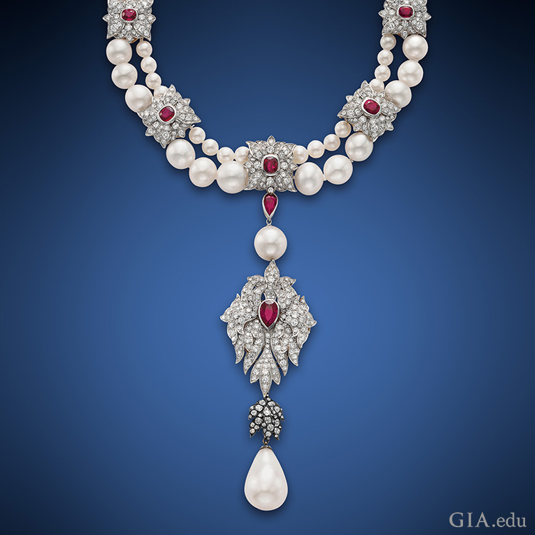 Cartier set Elizabeth Taylor's historic 50.56 ct La Peregrina pearl as part of the pendant to this two-strand pearl, ruby and diamond necklace. Courtesy: Christie's