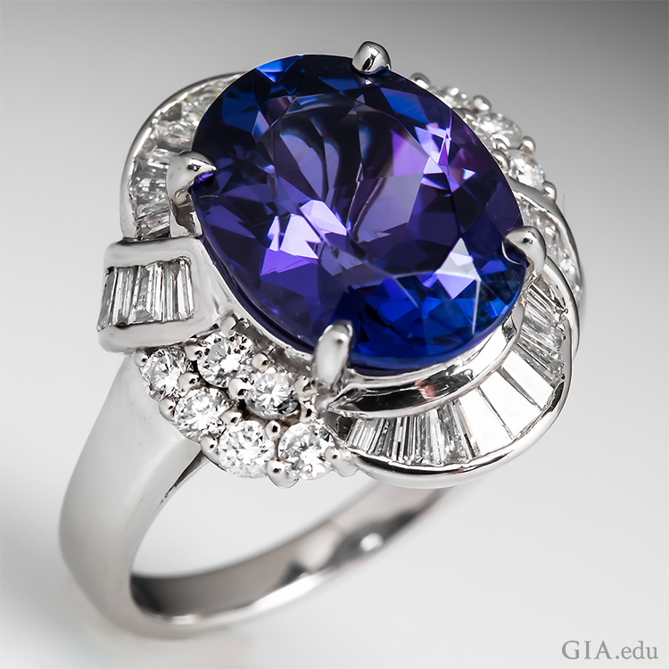 This tanzanite ring boasts the December birthstone with a 5.59 carat oval tanzanite surrounded by 28 tapered baguettes and 12 round brilliant cut diamonds.