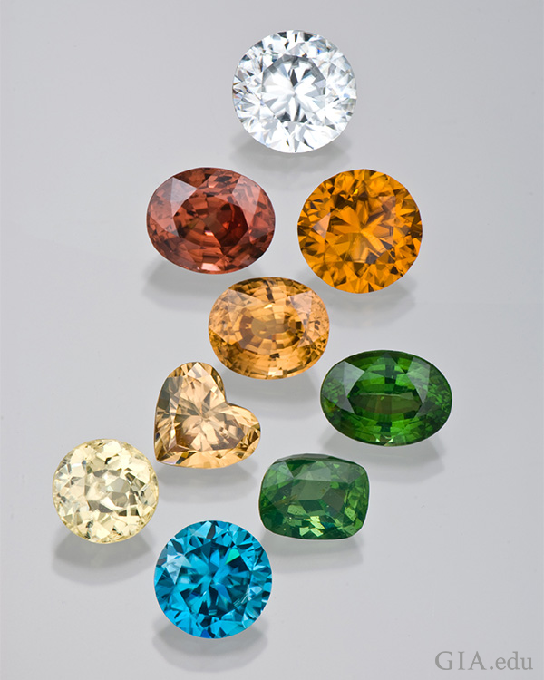 The December birthstone zircon is displayed in an array of colors of blue, green, yellow, orange, red, and clear.