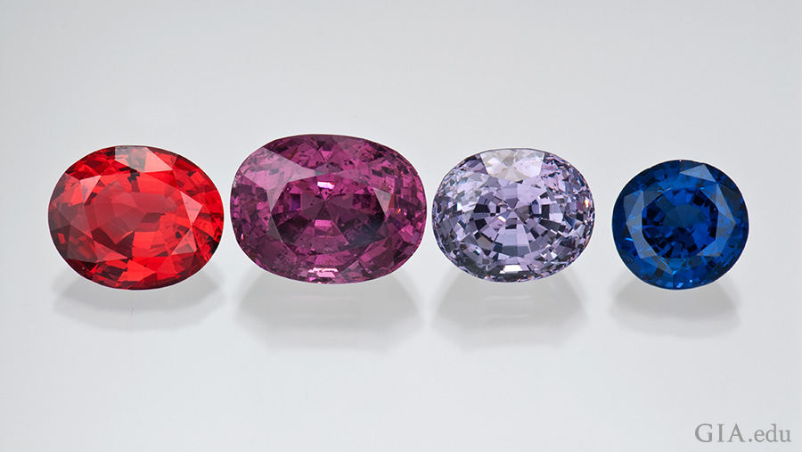 These spinels represent several different hues and countries. From left to right: a 10.92 ct oval red spinel from Mogok, a 20.08 ct cushion-cut violet spinel from Myanmar, a 13.78 ct oval violet spinel from Myanmar and a 7.92 oval dark blue spinel from Ratnapura, Sri Lanka.