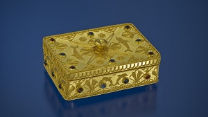 A rectangle-shaped gold box, decorated with filigree, granulation and gems.